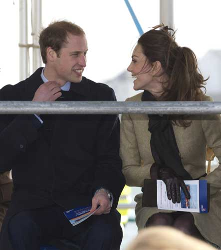 Britain&#39;s Prince William, left, is accompanied by his fiancee Kate Middleton as they visit Trearddur Bay Lifeboat Station on the island of Anglesey, Wales, Thursday, Feb. 24, 2011. Several hundred people cheered as Prince William and fiancee Kate Middleton made a rare public appearance Thursday to dedicate a new lifeboat. They plan to marry April 29 at Westminster Abbey.   <span class=meta>(&#40;AP Photo&#47;Jon Super&#41;)</span>
